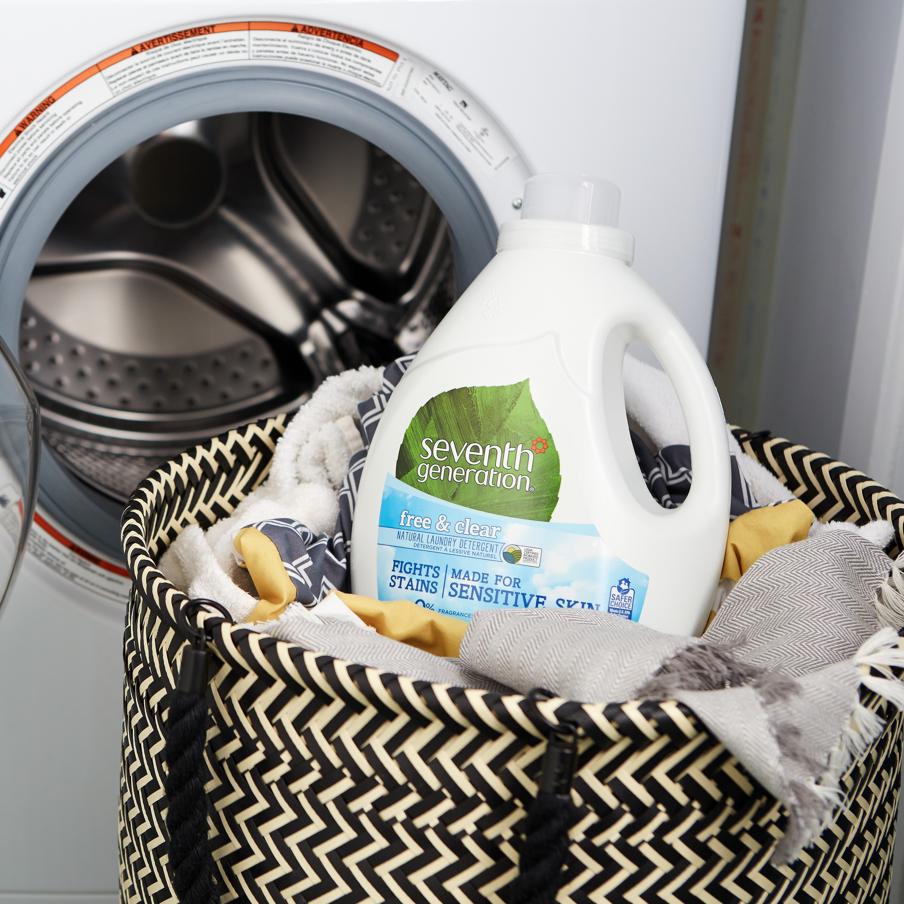 Assorted F&C Seventh Generation products in laundry basket